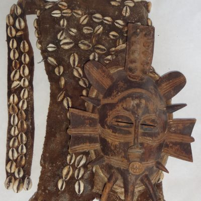 African Senufo Kpelie dance mask, with hood of fibre and cowrie shells