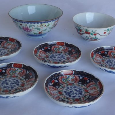 Collection of antique Chinese porcelain: two bowls and five Imari serving plates.