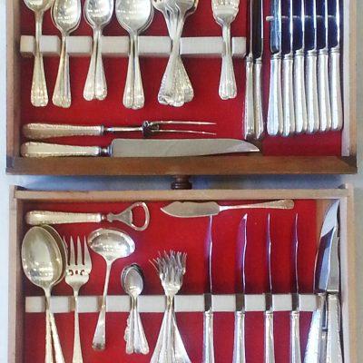 Set of sterling silver Birks flatware, in a two-drawer walnut cutlery cabinet.