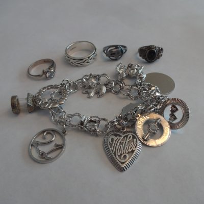 Sterling charm bracelet and rings