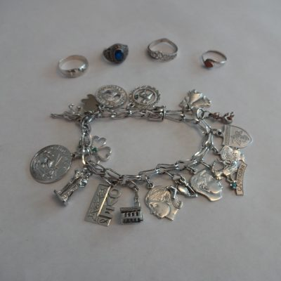 Sterling silver jewelry: charm bracelet and four rings