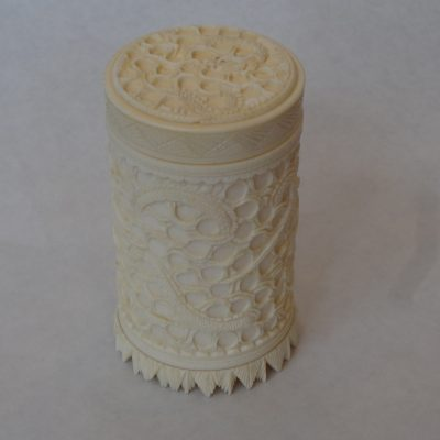 Hand-carved Chinese ivory box with lid in intricate dragon motif
