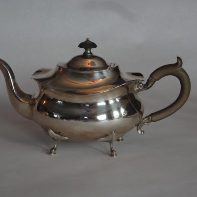 Sterling silver teapot with wooden handle