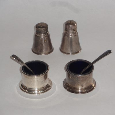Set of four sterling salts, two with glass inserts and spoons