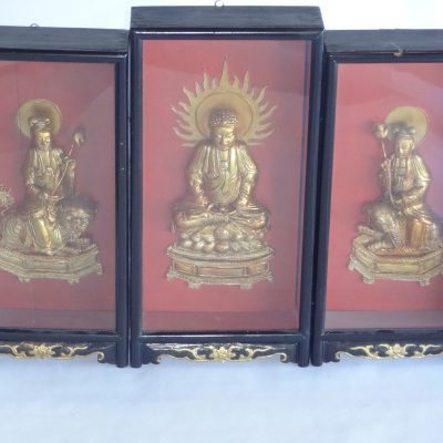 Three antique hand-carved wood and gold lacquer Chinese warrior and Buddha figures in ornate shadow box frames.