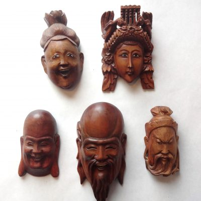 Set of five small Chinese masks with ivory teeth