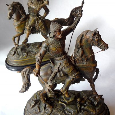 Pair of speltre statues of Cavaliers on rearing horses, on wooden bases. Circa 1920