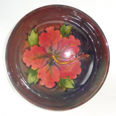 Moorcroft Hibiscus bowl with flambe glaze, painted Walter Moorcroft initials / top view