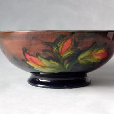 Moorcroft Hibiscus bowl with flambe glaze, painted Walter Moorcroft initials / side view