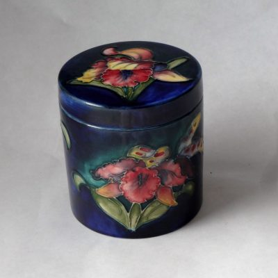 Moorcroft covered dish/humidor in orchid design.