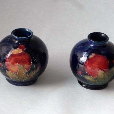 Pair of Moorcroft bud vases, pomegranate design.