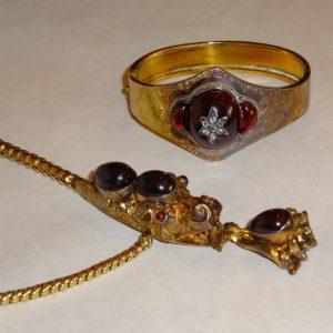 Gold serpent necklace, and bangle bracelet