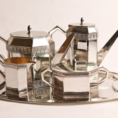 63   Art Deco tea set.  Silver       plated Including: Tea pot;  coffee pot; cream and sugar;  and tray
