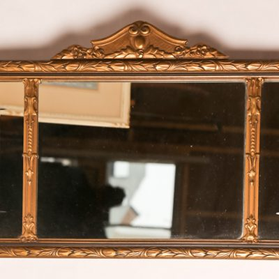 85   Wall mirror.  Three sections, in gilt plaster frame.  Early  20th century.