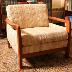 23.  Three seat sofa and armchair.  Teakwood construction. Mid 20th century.