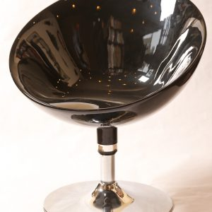 31.  Mid-century swivel chairs.  Black on chrome base. With similar glass topped side table. Three pieces. Late 20th century.