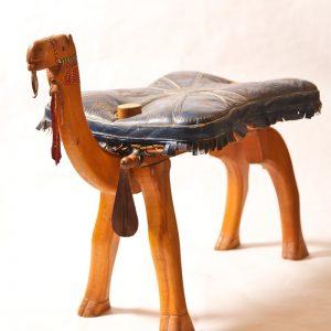 79.  Footstool. African hardwood. Camel motif. Mid 20th century.