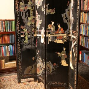 43.  Old Chinese parlour screen with coloured enamel scenes of court ladies playing musical instruments (major losses).