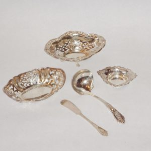 90.  Collection of miscellaneous pierced sterling silver serving pieces. Five pieces. Mid 20th century.