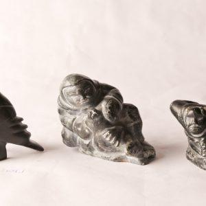102. Three Inuit soapstone carvings. Mathewsie Amidlak woman and seal; Peter Etiodloie hunter; Martha Ekutisluk bird.